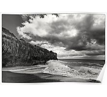 Rocks on a stormy sea Poster