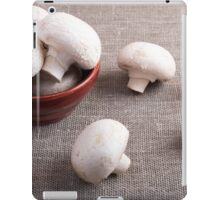 Champignon mushrooms and onions on the table iPad Case/Skin
