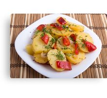 Closeup view on slices of potato stew with vegetables Canvas Print