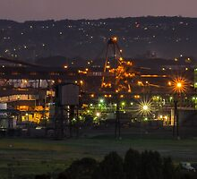Sunset over Industrial area by VinImagery