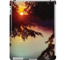 setting sun shining through the trees and reflecting off a northern lake iPad Case/Skin