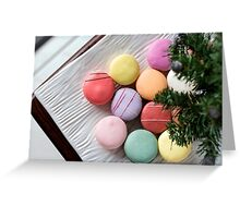 Traditional french macaroons under a little christmas tree Greeting Card