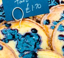 Delicious round blueberry tarts in British market Sticker