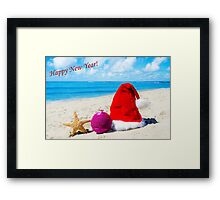 Christmas hat with starfish on the beach Framed Print