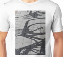 Bicycle shadow on the ground. Unisex T-Shirt