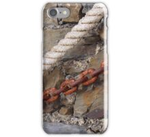 Rope and metal chain on grungy stone wall. iPhone Case/Skin