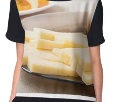 Slices of cheese and bread on a plate closeup Chiffon Top