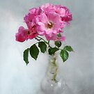 Deep Pink Roses in a Clear Glass Vase by LouiseK