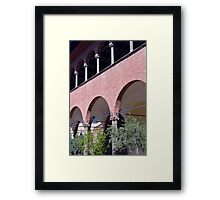 Building with red brick facade and arches in Siena. Framed Print