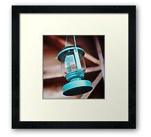 Old-fashioned blue lantern. Wooden background. Framed Print