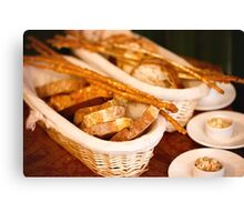 Slices of fresh-baked and breadsticks Canvas Print