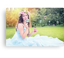 woman blowing bubbles young sitting Canvas Print