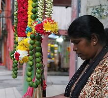 Selling flowers for the gods, KL by indiafrank