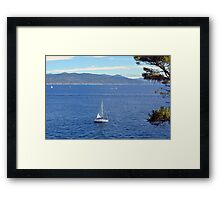 Sailing ships in the blue water of Portofino Framed Print