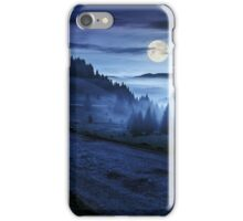road near foggy forest in mountains at night iPhone Case/Skin