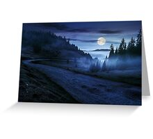 road near foggy forest in mountains at night Greeting Card