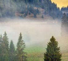 fog on hot sunrise in mountains Sticker