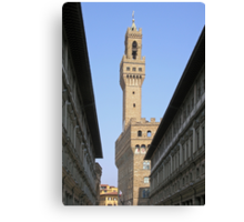 The tower of the Palazzo Vecchio seen through the Uffizi, Centro Storico, Florence, Italy Canvas Print