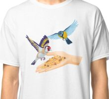 Goldfinch and titmouse are flying over hand with cereals Classic T-Shirt