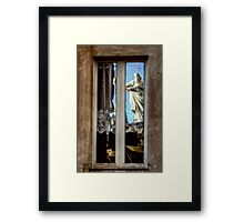 Statue reflection on window Framed Print