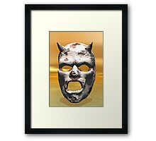 MASK OF STONE Framed Print