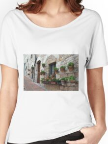 Stone buildings from Assisi with flowers in pots. Women's Relaxed Fit T-Shirt