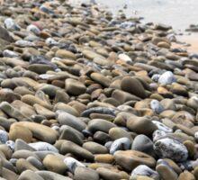 pebbled beach beside the links Sticker