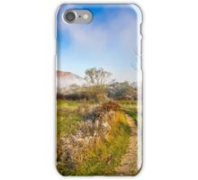rural landscape with road through agricultural meadow in fog iPhone Case/Skin