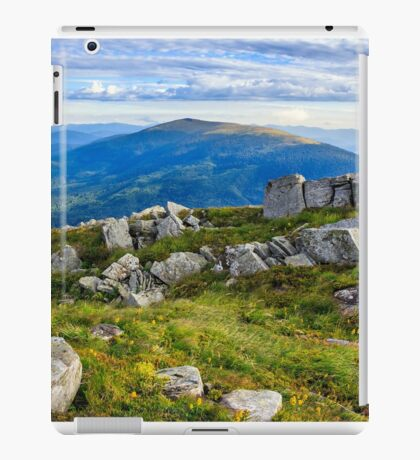 stones on a hill in front of the mountain iPad Case/Skin