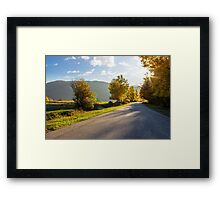 road going to mountains Framed Print