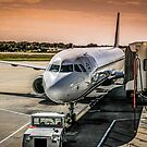Aircraft at the gate at sunset by Chris L Smith