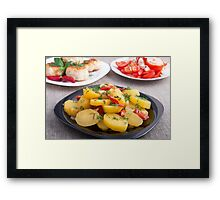 Stewed potatoes with bell pepper closeup Framed Print