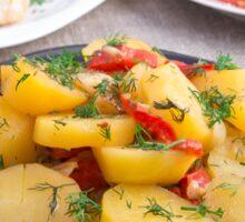 Stewed potatoes with bell pepper closeup Sticker