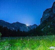 Moon rises over beautiful mountain valley by Gavin Heffernan