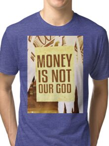Money Is Not Our God Tri-blend T-Shirt