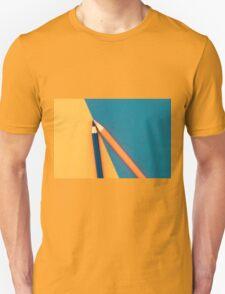 Orange and Dark Blue coloured pencils and paper Unisex T-Shirt