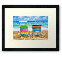 Beach chairs by the ocean Framed Print