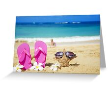 Flip flops and starfish with sunglasses on sandy beach Greeting Card