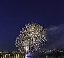 Fireworks over a river by Josef Pittner