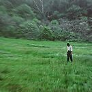Young Woman Standing in a Field by Kellice Swaggerty