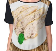 Baked chicken breast sliced on a white plate Chiffon Top