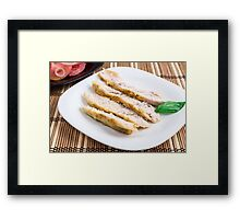 Cut the fillet pieces baked chicken on a white plate Framed Print