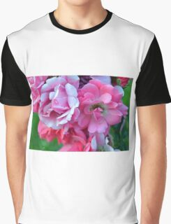 Natural background with pink roses and green leaves. Graphic T-Shirt