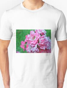 Natural background with pink roses and green leaves. Unisex T-Shirt