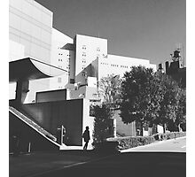 Shadow figure against cityscape Photographic Print