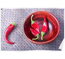Chilli hot red pepper in a brown wooden bowl Poster
