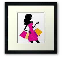 Shopping girl with pink bags silhouette Framed Print