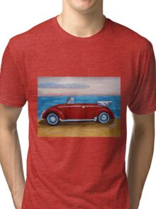 red VW bug with sea Tri-blend T-Shirt