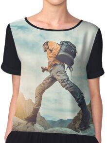 Traveler hipster man walking in front of beautiful mountain landscape. Chiffon Top