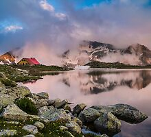 Hut in high mountain at sunset by jordanrusev